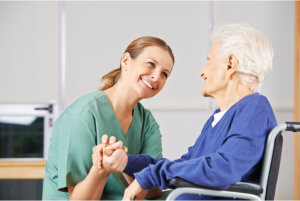 caregiver smiling to the senior woman